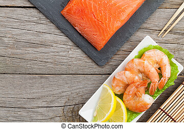 Fresh sea food on wooden table with copy space