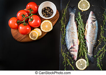 fresh seabass, spices fnd tomato on the table - fresh...