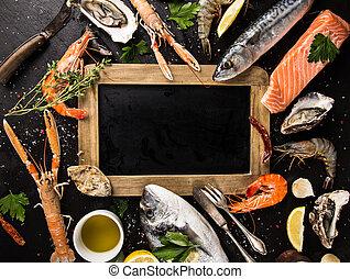 Fresh seafood on black stone. - Fresh seafood on black stone...