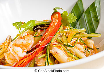 fresh seafood thai style salad with glass noodles on a bowl close up
