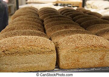Freshly baked hand-made organic sesame bread loaves