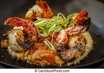 Fresh Shrimp and Creamy Grits - Close up of fresh grilled...