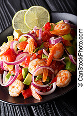 Fresh shrimp ceviche appetizer with avocado, peppers,...