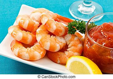 Fresh Shrimp on Aqua Background - Fresh shrimp are a...
