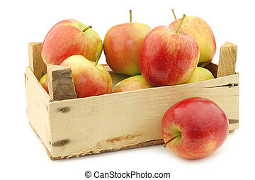 "fresh ""Sissi red"" apples in a wooden crate"