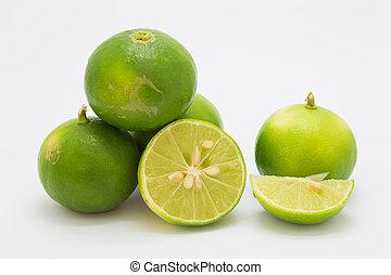 Fresh slice limes on white background