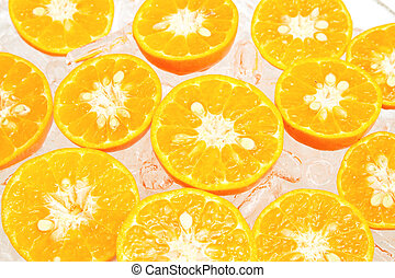 Fresh slice oranges in ice on white background