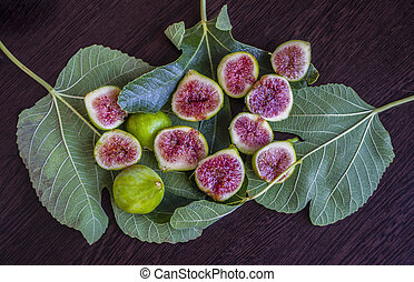 Fresh sliced figs on a green leaves. Tropical fruit. Top ...