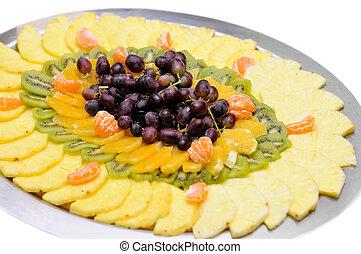 Fresh sliced fruit on the tray