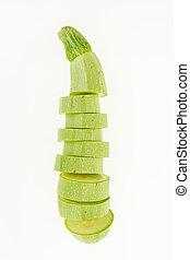 Fresh sliced zucchini , isolated on white background