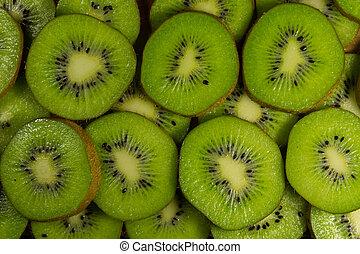 Fresh slices of kiwi fruit for background