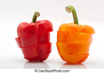 slices of red and orange pepper isolated on white background