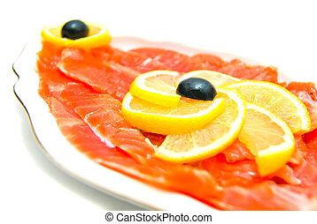 Fresh smoked salmon close-up on white