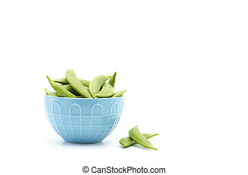 Fresh Snap Peas - Fresh snap peas in the pod photographed on...