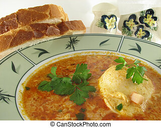 fresh soup in a bowl garnished with parsley