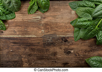 Freshly picked spinach on a background
