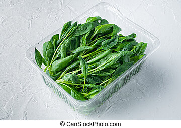 Fresh spinach , on white background, in plastic pack