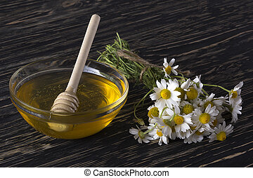 Fresh spring honey with chamomile flowers