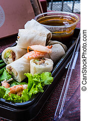 Fresh spring noodle rolls with herbs, vegetable or crab meat, poured with sour