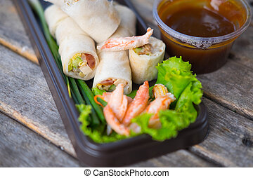 Fresh spring rolls, vegetables wrapped in dough, topped with crab , eaten with sweet sauce
