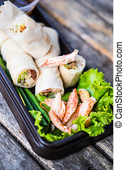 Fresh spring rolls, vegetables wrapped in dough, topped with crab