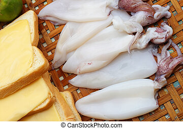 Fresh squid in a basket - for cooking.