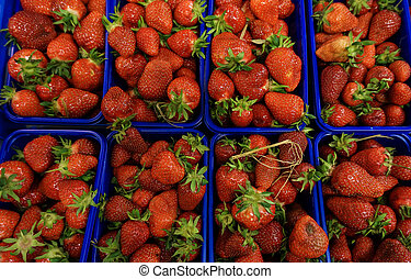 fresh stawberrie.  strawberries in baskets at market