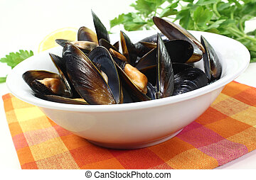 mussels in a white bowl