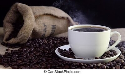 fresh steaming coffee in cup - fresh steaming coffee in...