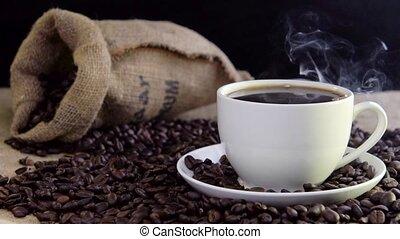 fresh steaming coffeein cup - fresh steaming coffeein white...