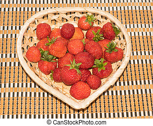 fresh strawberries in a basket heart shape