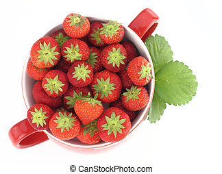 Fresh strawberries in a red jar