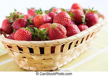 Fresh strawberries in a wicker basket - vitamin berries
