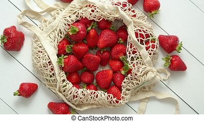 Fresh strawberries in eco-friendly package on white wooden ...