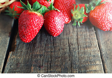 fresh strawberries on a wooden background
