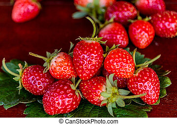 Fresh strawberries on old table wood