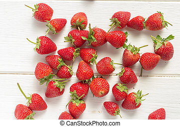 Fresh strawberries on white wooden table. Top view.
