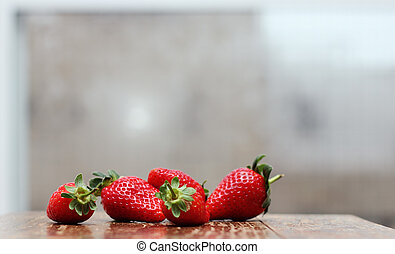fresh strawberries on wooden vintage table near the window