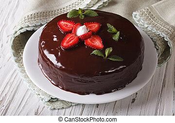 Fresh strawberry cake with chocolate topping horizontal...