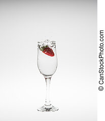fresh strawberry dropped into water with splash on white backgro