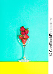Fresh strawberry in a cup on blue