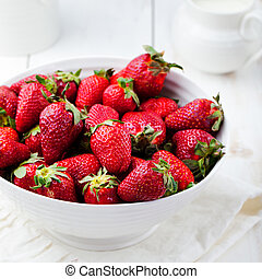Fresh strawberry in a white bowl Rustic background