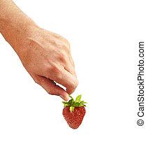fresh strawberry in hand