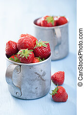 fresh strawberry in old cups
