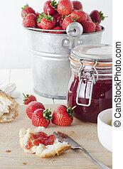Fresh Strawberry Jam - A farmhouse kitchen table scene of...