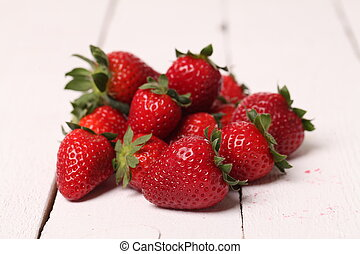 Fresh strawberry on a white table