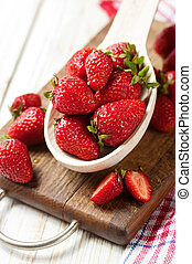 Fresh strawberry on white wooden background