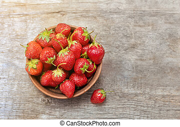 Fresh strawberry on wooden background, top view.
