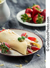 Fresh strawberry pancakes with mint leaf