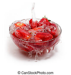 Fresh strawberry  under running tap with water drops
